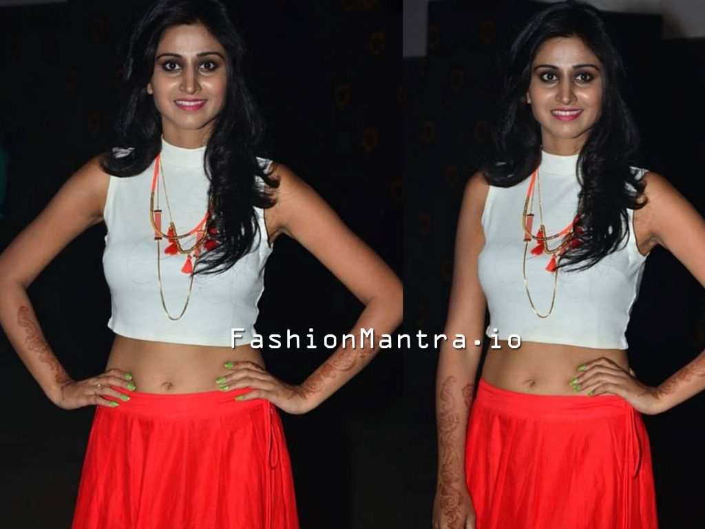 Shamili in a long skirt and crop top